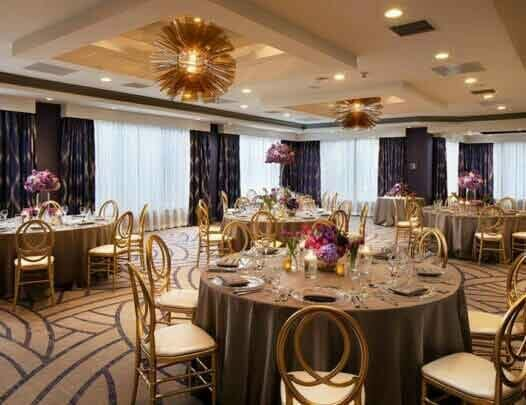 inside event venue decorated fancy with circle dining tables